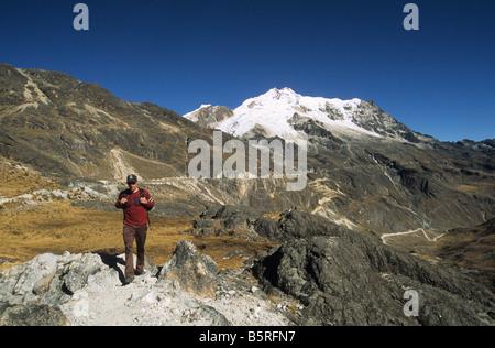 Trekker, Mount Huayna Potosi in background, Cordillera Real, Bolivia - Stock Photo