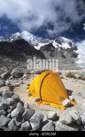 Campsite at Laguna Glaciar, Mt Illampu in background, Cordillera Real, Bolivia - Stock Photo