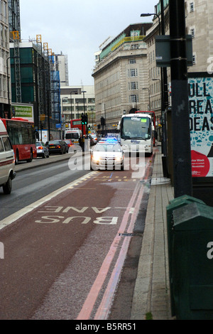 Police car speeding in a bus lane in London during an emergency - Stock Photo