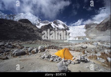 Campsite at Laguna Glaciar, Mt Illampu in background, Cordillera Real, Bolivia - Stock Photo