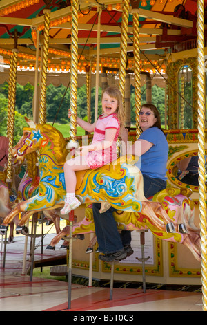 Wiltshire Steam vintage Rally England 2008 Mother Child on Vintage Galloper merry go round - Stock Photo