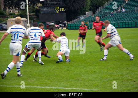 Men play a game of rugby in the city of Bath Somerset England - Stock Photo
