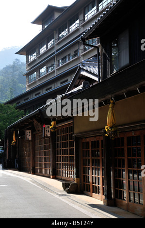 Traditional shop fronts in modern Japanese street scene, Miyajima Island, Japan - Stock Photo