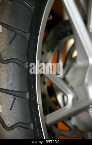 Closeup of motorbike wheel - Stock Photo