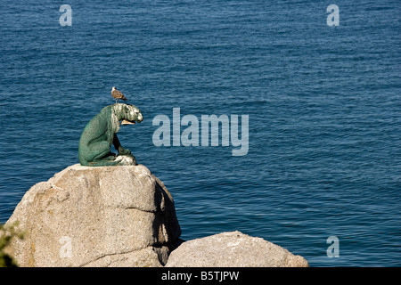 South Africa the area around Cape Town statue of a cheetah facing the ocean near Noordhoek - Stock Photo