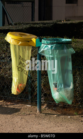 Litter bins in Paris France with yellow bin for recycling - Stock Photo