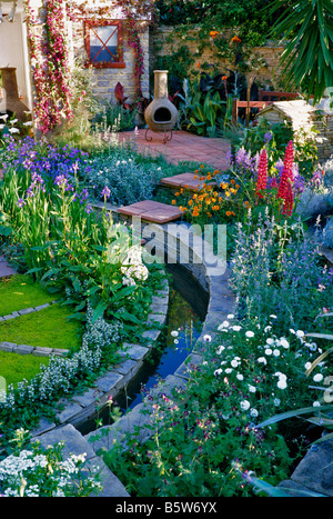 Flowering Patio and Rill in a Chelsea Garden - Stock Photo