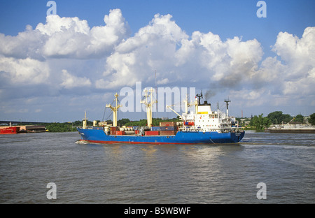 A small freighter cargo carrying ship on the Mississippi River near St Louis, Missouri. - Stock Photo