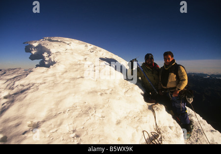 Climbers on the summit of Mount Huayna Potosi, Cordillera Real, Bolivia - Stock Photo