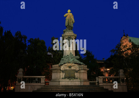 Statue of the Polish poet Adam Bernard Mickiewicz (1798-1855) in Warsaw, Poland - Stock Photo