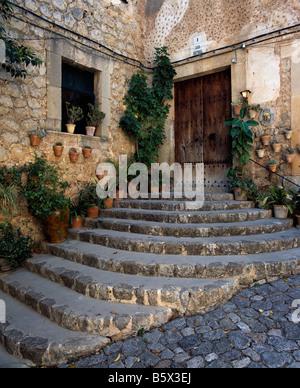 Doorway with steps at Valldemossa, Mallorca, Balearics, Spain - Stock Photo