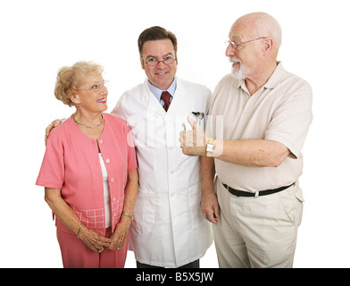 Senior couple giving a thumbs up to their eye doctor after a successful office visit Isolated on white - Stock Photo