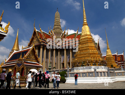 Tourists visit the Grand Palace complex in Bangkok, Thailand - Stock Photo