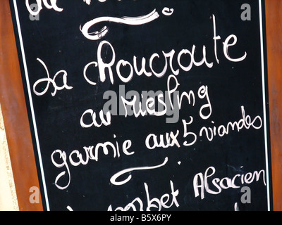 Alsatian restaurant blackboard menu with Riesling sauerkraut with fives differents meats - Alsace - France - Stock Photo