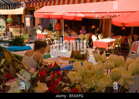 Street restaurants in the flower market of Vielle Ville the old quarter of Nice Cote D Azur France - Stock Photo