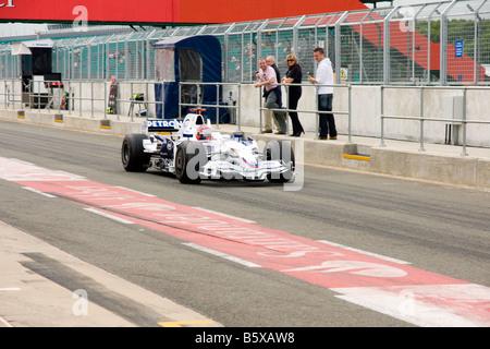 BMW Sauber Formula 1 car leaving the pit lane - Stock Photo