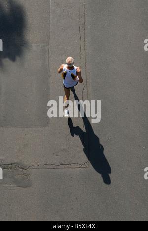 elderly Marathon Runner seen from above - Stock Photo