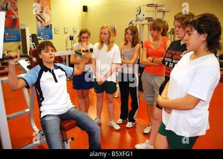 fitness class at the gym listening to instructor - Stock Photo