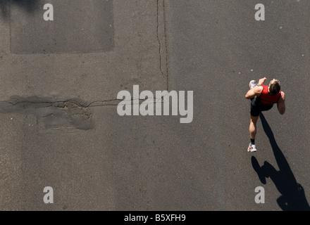 Marathon Runner seen from above - Stock Photo