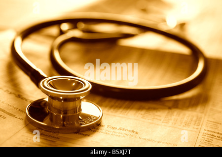 Doctor's stethoscope on investment business newspaper. - Stock Photo