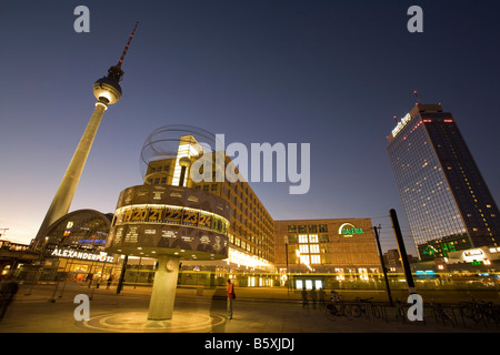 Alexanderplatz world clock TV tower Galeria Kaufhof warehouse Park Hotel night in Berlin - Stock Photo
