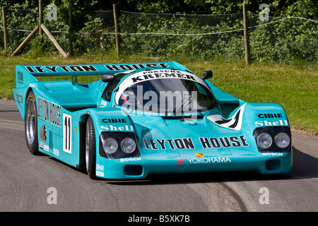 1987 Porsche 962 Le Mans racer with driver John Watson at Goodwood Festival of Speed, Sussex, UK. - Stock Photo