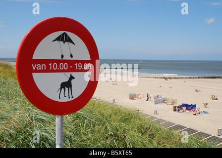 warning sign at Domburg beach Zeeland Netherlands - Stock Photo
