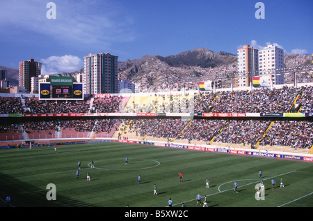 Football match taking place inside Hernando Siles Olympic stadium, Miraflores, La Paz, Bolivia - Stock Photo
