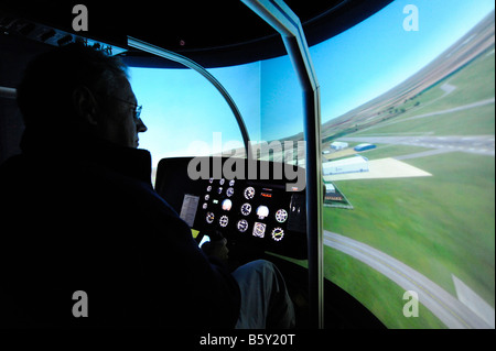 Pilot training in a helicopter simulator - Stock Photo