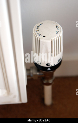 A manual thermostat control on a central heating radiator - Stock Photo