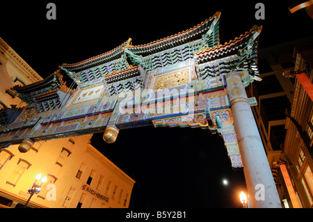 The Chinatown arch at Gallery Place, downtown Washington DC, a night scene in the city. - Stock Photo