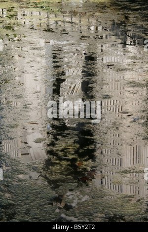 statue reflected in lake in villa borghese rome italy - Stock Photo
