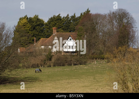 large detached Country House Amberley West Sussex in the english countryside - Stock Photo
