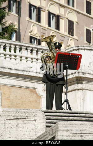 fire brigade music band member with sheet music stand on spanish steps in rome - Stock Photo