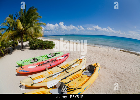 Ocean kayaks on Shoal Bay West beach on the caribbean island of Anguilla in the British West Indies - Stock Photo