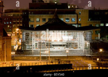 welsh assembly government  Senedd parliament building Cardiff Bay illuminated at night, Wales UK - Stock Photo