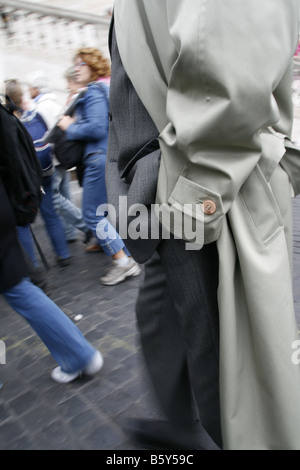 business man with hands in pockets in street in city town - Stock Photo