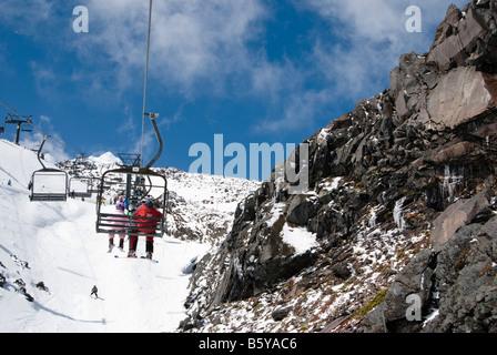 Chairlift on the slope of Mount Ruapehu - Whakapapa Ski Field - biggest in New Zealand - Stock Photo