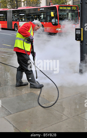 Oxford Street London steam cleaning chewing gum from pavements - Stock Photo