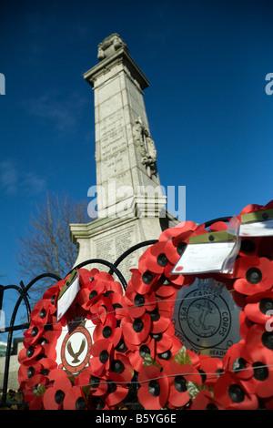Poppy wreaths around the base of the War Memorial, Newmarket Suffolk UK - Stock Photo
