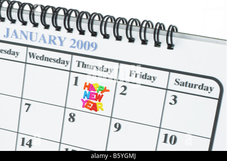 Calender showing January 1 and Happy New Year - Stock Photo