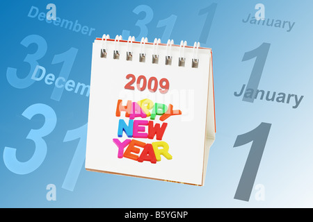 Desktop calendar showing 2009 with dates of Dec 31 and Jan 1 in the background - Stock Photo