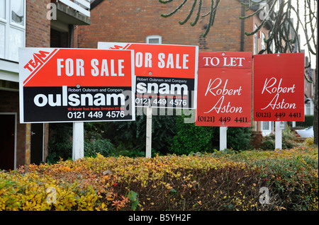 A group of house for sale signs in Birmingham West Midlands England UK - Stock Photo