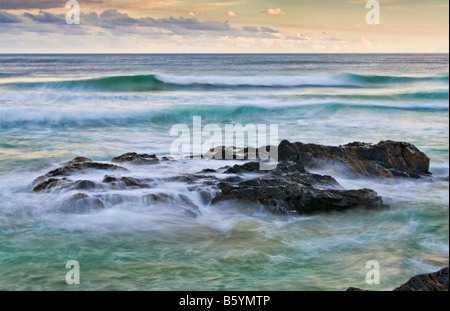 fine art image of strong and resilient rocks at the sea - Stock Photo