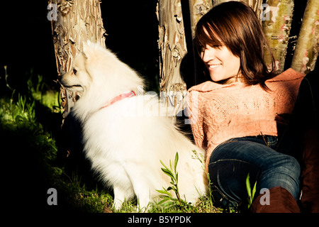 Young beautiful woman with her pet in the park - Stock Photo