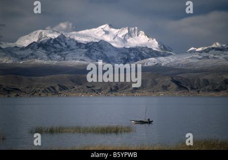 Fishing boat, Cordillera Real behind, Lake Titicaca, Bolivia - Stock Photo