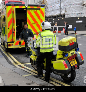 London Oxford Street ambulance & motorbike paramedic respond to emergency call to this busy West End shopping street - Stock Photo