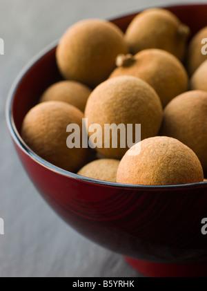 Longan in Wooden Bowl - Stock Photo