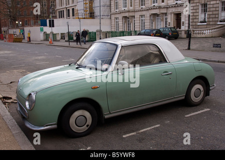 Green and white two tone Nissan Figaro classic cult car - Stock Photo