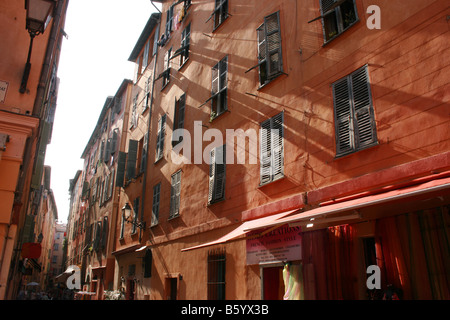tall apartments in the old town area of Nice, in the South of France - Stock Photo
